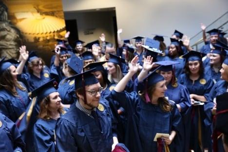 Graduates Raise Hands